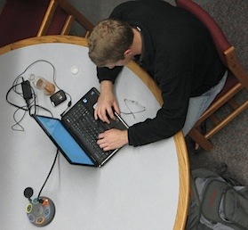 Drake student working on his laptop.