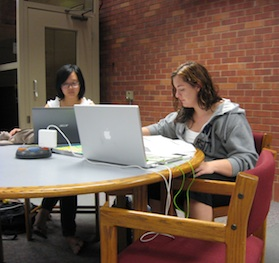 Drake students studying in the library