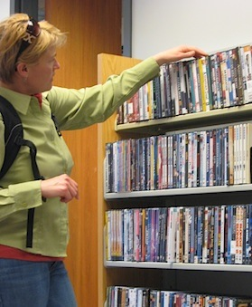 Picture of a Drake faculty member browsing the DVD collection
